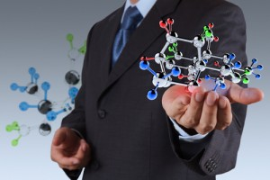 businessman holding a chemcial molecule as science concept